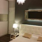 Elegancka sypialnia zszafą nawymiar